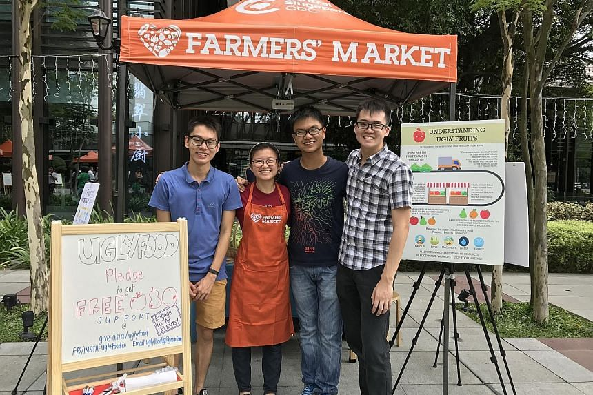UglyFood co-founders (from left) Lee Zhong Han, 21; Yeo Pei Shan, 23; Foo Lin Geng, 23; and Augustine Tan, 23, at Zhongshan Park on Aug 26 last year.
