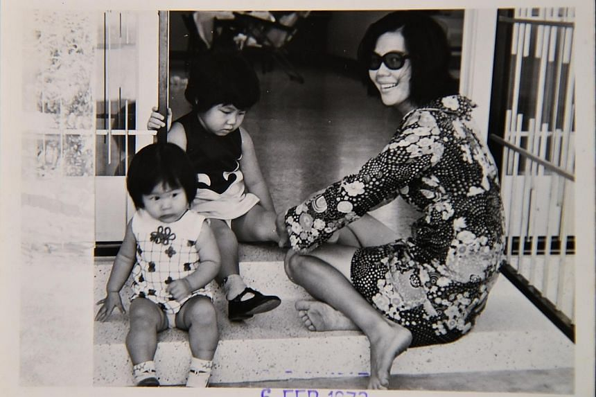 Left: Madam Lee Siew Eng, one of the oldest active Great Eastern Life insurance agents, has been selling insurance for 45 years. Below left: Madam Lee in a February 1973 photo with her daughters Alice (left) and Grace. Below: Madam Lee also chaired t