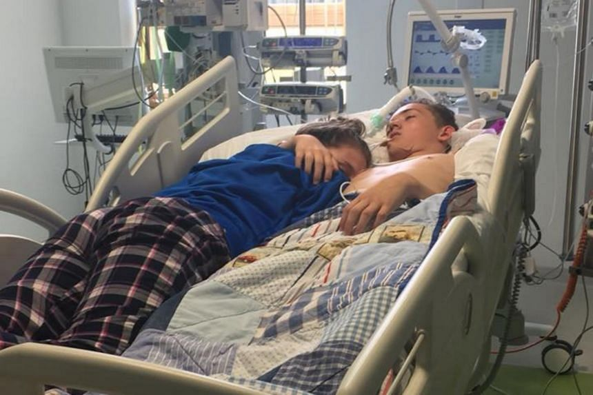British teenage girl Stephanie Ray hugging her boyfriend as he was taken off life support. Her Facebook post has since gone viral.