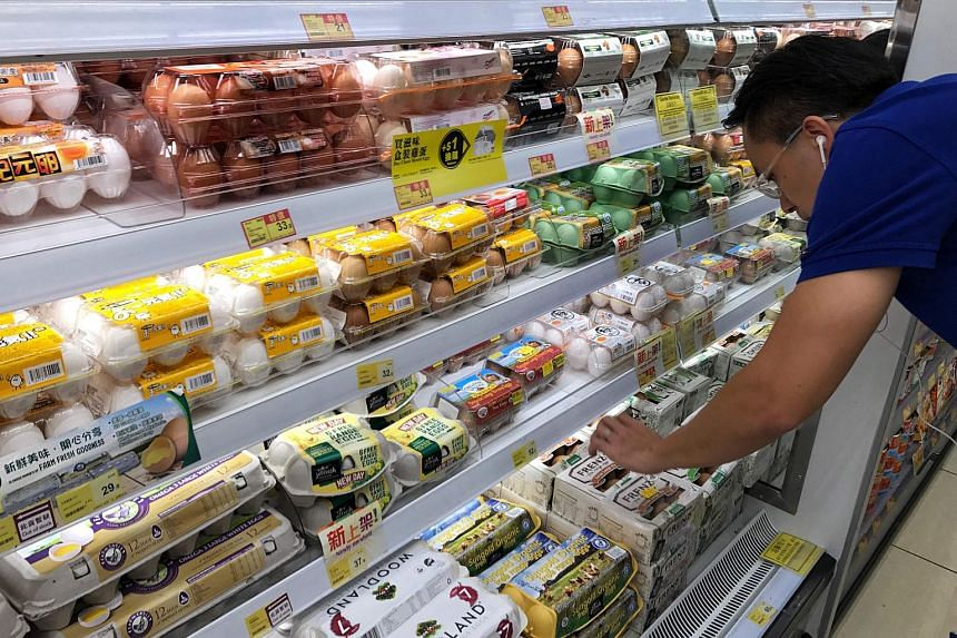 Cartons of eggs for sale on the shelves of a supermarket in Hong Kong.