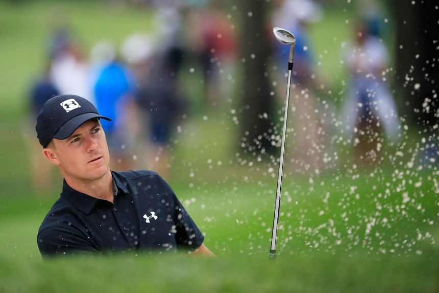 Spieth plays a shot from a bunker on the second hole during a practice round prior to the 2018 PGA Championship.