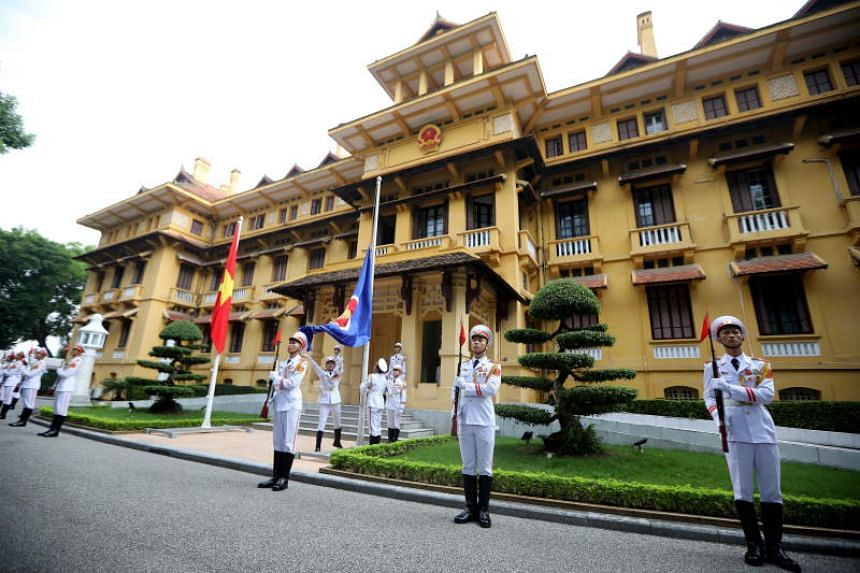 Members of an honour guard participate in the Association of South East Asian Nations (Asean) flag raising ceremony at the Ministry of Foreign Affair in Hanoi, Vietnam, on Aug 8, 2018. The ceremony is to mark the 51st anniversary of the founding of