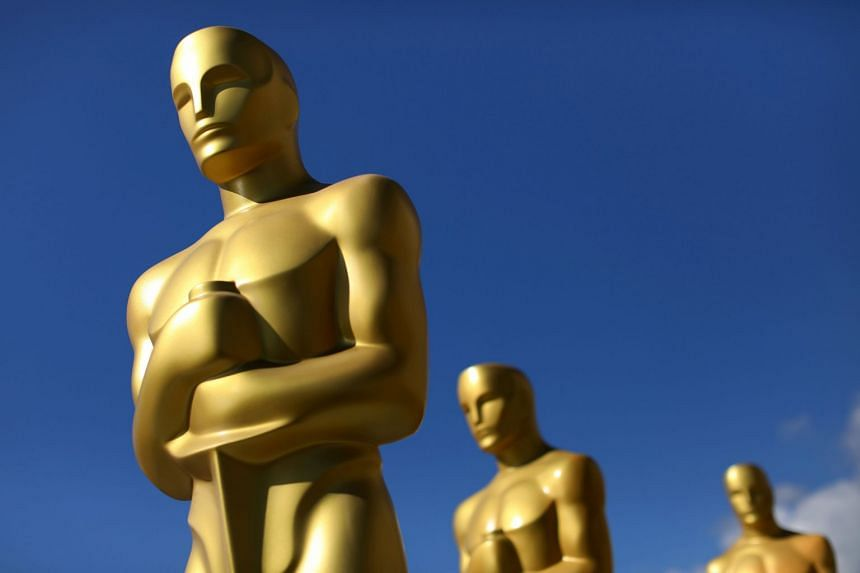 Oscar statues drying in the sunlight after receiving a fresh coat of gold paint for the 2017 ceremony.