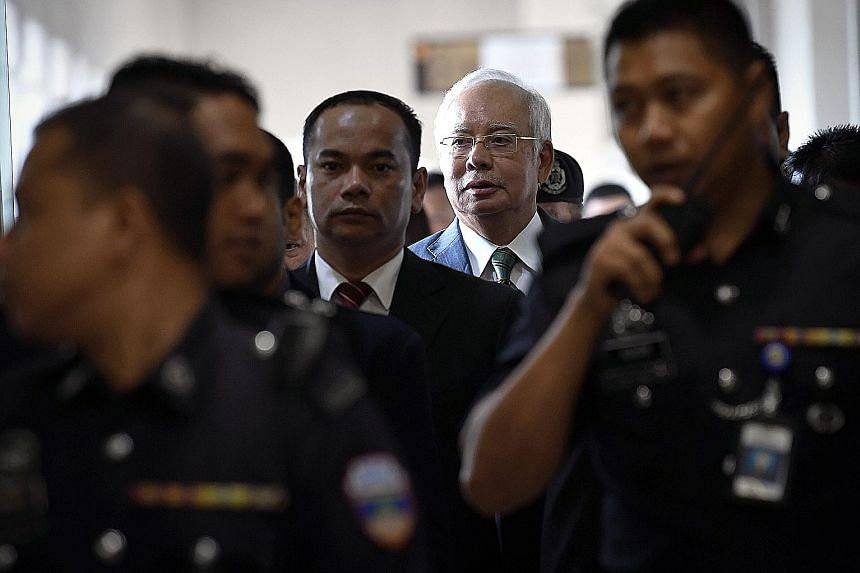 Former Malaysian prime minister Najib Razak, who now has seven criminal charges against him, leaving the Jalan Duta court complex in Kuala Lumpur yesterday.