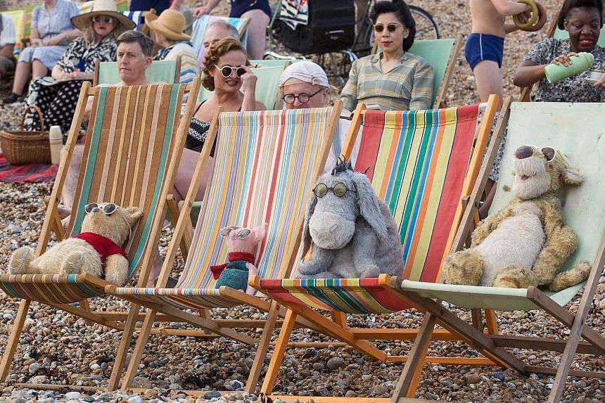 (From far left) Winnie the Pooh, Piglet, Eeyore and Tigger in the film Christopher Robin.