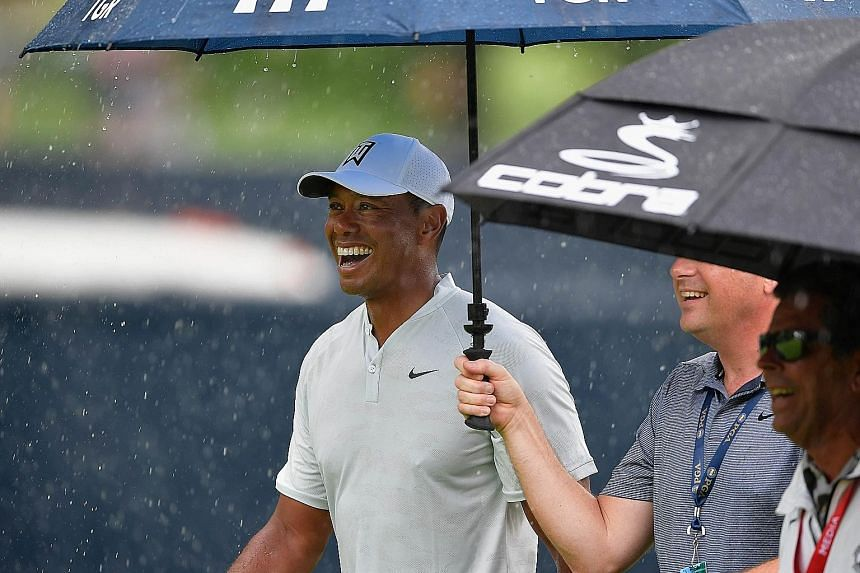 Rain or shine, Tiger Woods (during Tuesday's practice round) has all the reasons in the world to smile despite being without a Major title in decade. Even multiple winners can be ignored by the media when he is around.