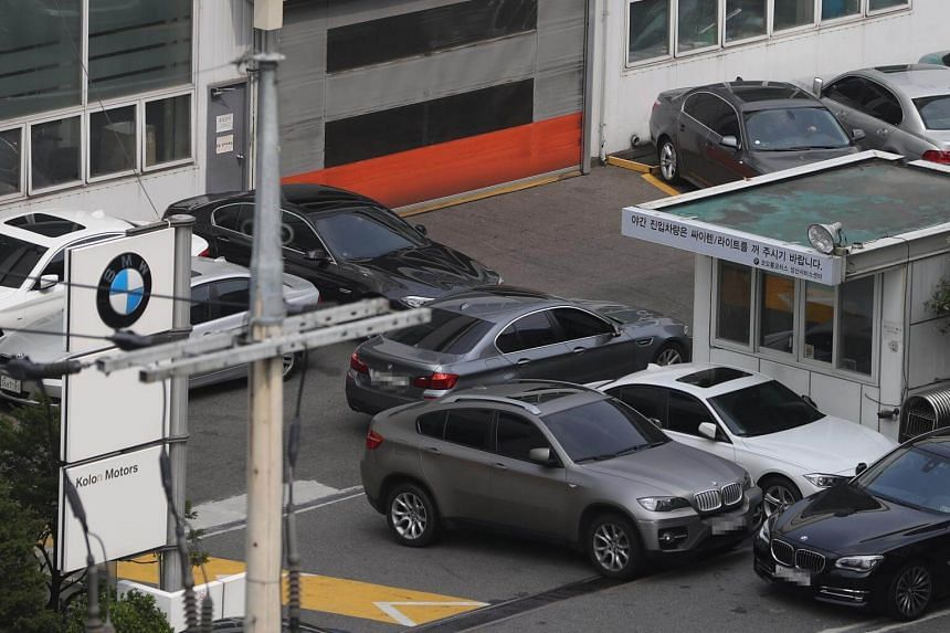 Cars seen at a BMW service centre in Seoul, South Korea, on July 26, 2018.