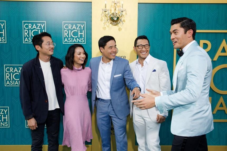 Celebrities (from left) Steven Yuen, Jae Suh Park, her husband Randall Park, Daniel Dae Kim and British-Malaysian actor Henry Golding attend the premiere of Crazy Rich Asians at the TCL Chinese Theatre IMAX in Hollywood on Aug 7, 2018.