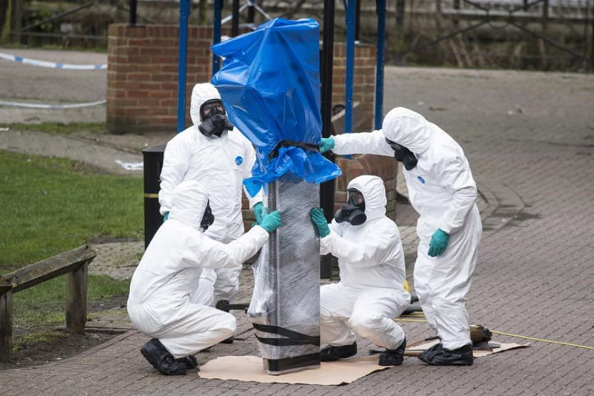 Army officers remove the bench where Sergei Skripal and his daughter Yulia were found, in Salisbury, Wiltshire, Britain, on March 23, 2018.