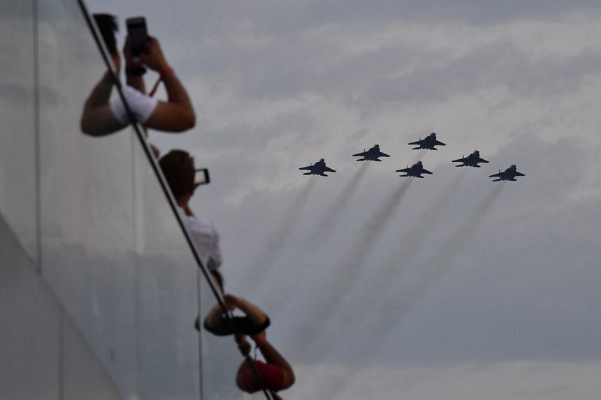 F-15SG fighter jets conducting a flyby in close formation during the National Day Parade on Aug 9, 2018.