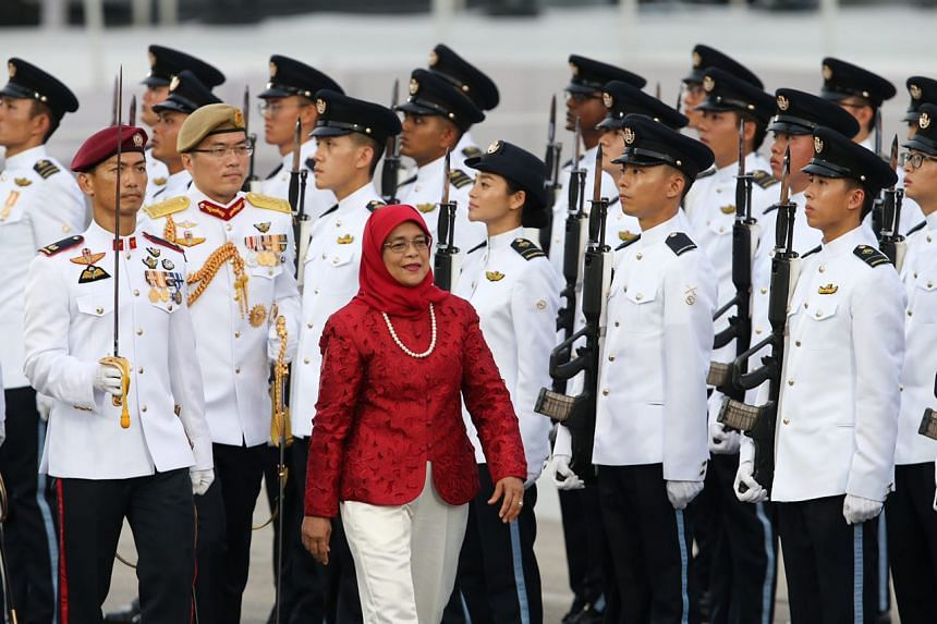 President Halimah Yacob inspecting the guard of honour at the National Day Parade on Aug 9, 2018.