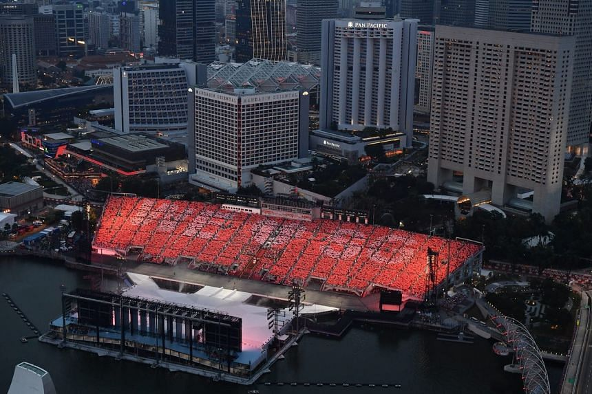 """The crowd forming the text for """"We love SG"""" at the Floating Platform on Aug 9, 2018."""