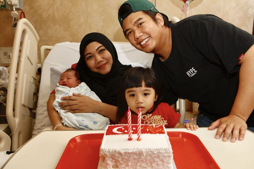 Ms Nuraidillah and Mr Firman Akhfar with their two-year-old daughter Nurdaneya Filza, two, and their newborn son Muhammad Aqil Fayyadh, both of whom were born on National Day.