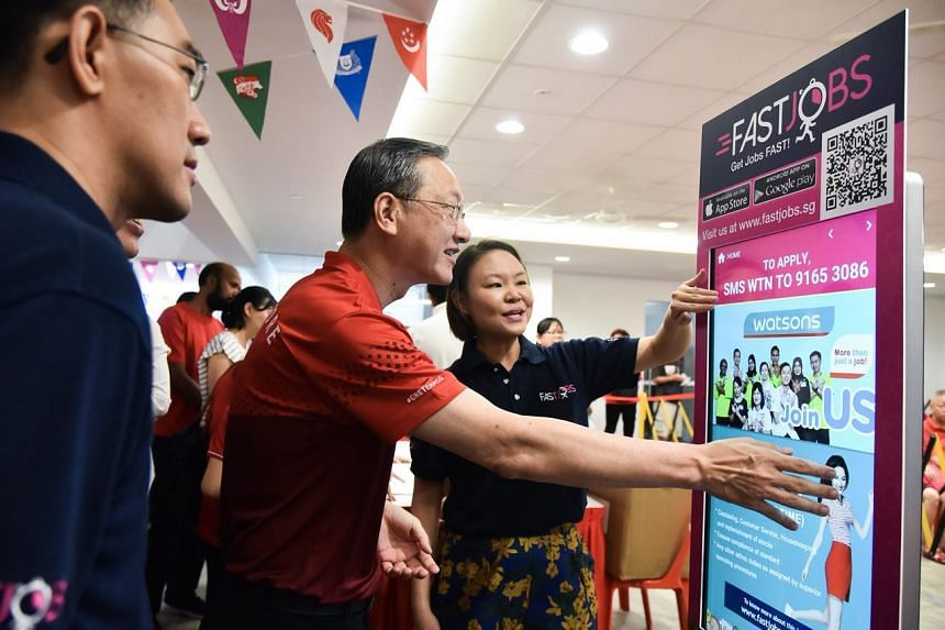 (From left) SPH's chief of digital business Julian Tan, Radin Mas MP Sam Tan and FastJobs' regional business development director Joelle Pang checking out the first FastJobs kiosk at Radin Mas Community Club, on Aug 9.