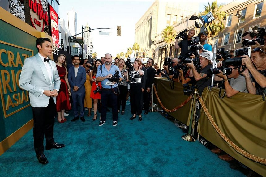 Henry Golding poses at the premiere of Crazy Rich Asians in Los Angeles, California, on Aug 7, 2018.