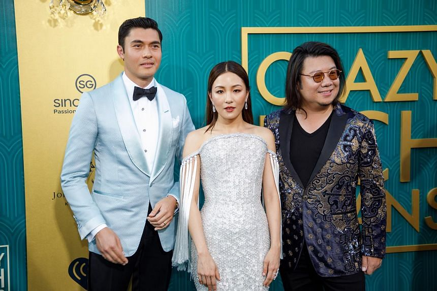 (From left) Henry Golding, Constance Wu and book author Kevin Kwan attend the US premiere of Crazy Rich Asians at the TCL Chinese Theatre IMAX in Hollywood, Los Angeles, California, on Aug 7, 2018.