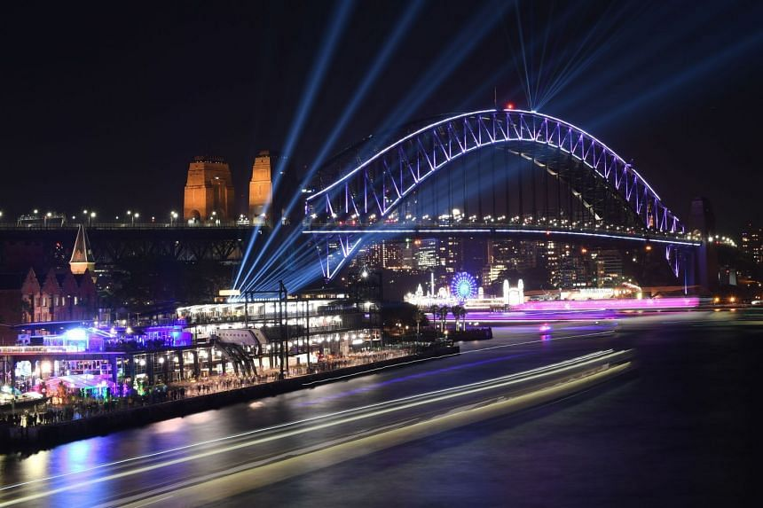 A ship passes the Harbour Bridge during the Vivid Sydney festival, on May 25, 2018.