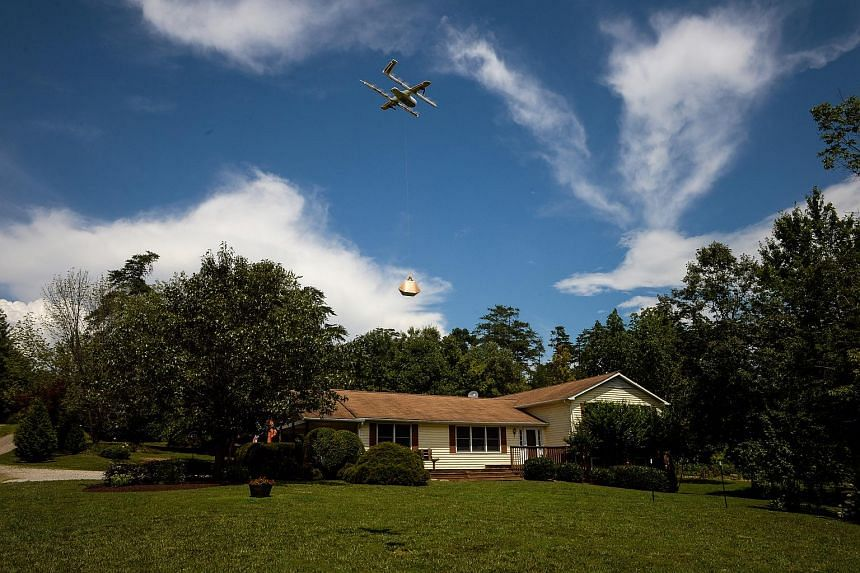 A drone delivering a package at a home during a demonstration in Blacksburg, Virginia, US, on Aug 7, 2018.