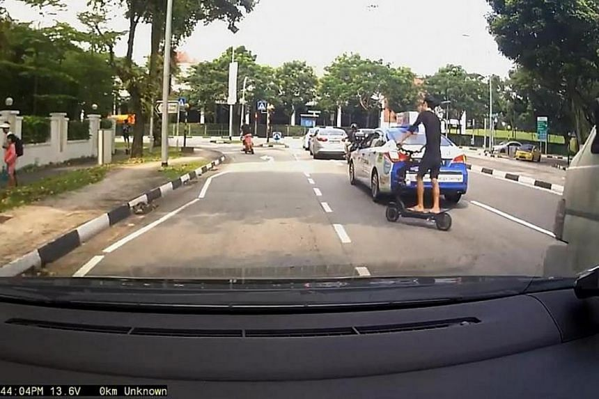 Netizens have expressed outrage at these e-scooter riders, who were caught weaving from one lane to another.
