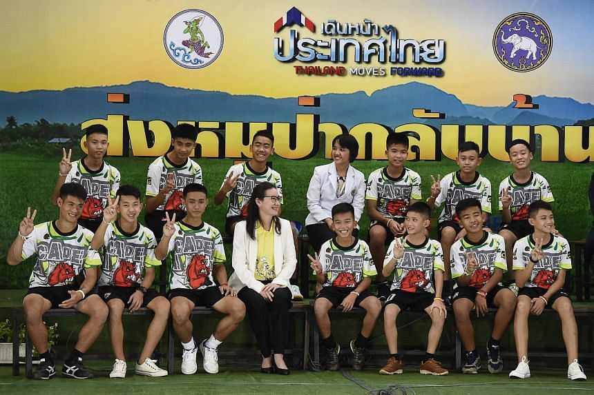 A file photo of the 12 Thai boys and their football coach, at a press conference in Chiang Rai on July 18, 2018, following their discharge from the hospital.
