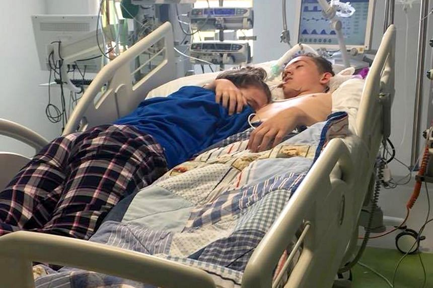 Stephanie Ray giving her boyfriend, Blake Ward, one last hug before his life support was switched off. She shared the picture on Facebook. Blake was placed on life support after he was swept out to sea during a family trip last week.