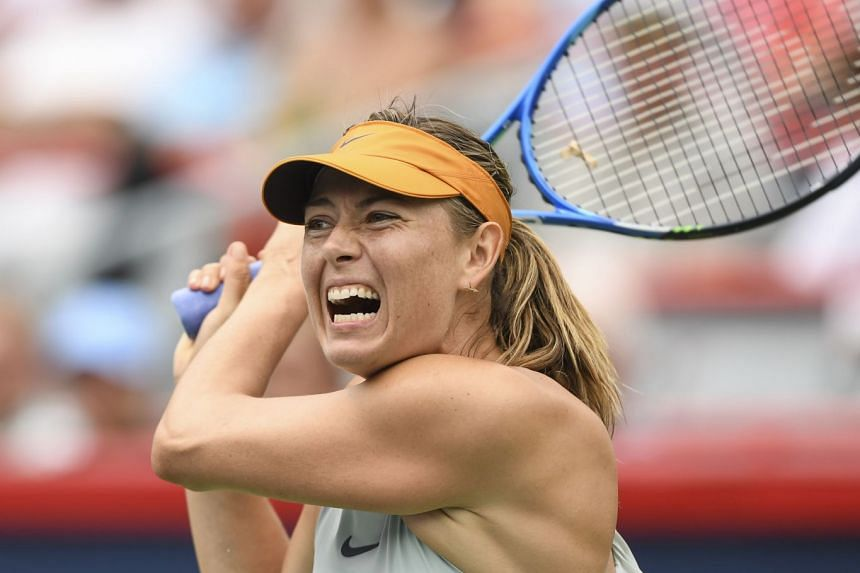 Sharapova hits a return against Daria Kasatkina of Russia.