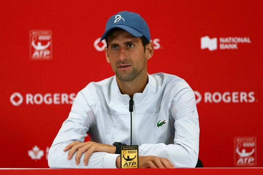 Djokovic speaking to the media after defeating Peter Polansky.