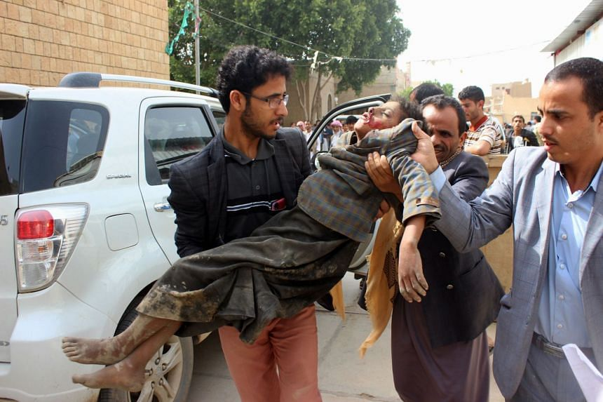 A Yemeni child is transported to a hospital after being being wounded in a reported air strike in Saada.
