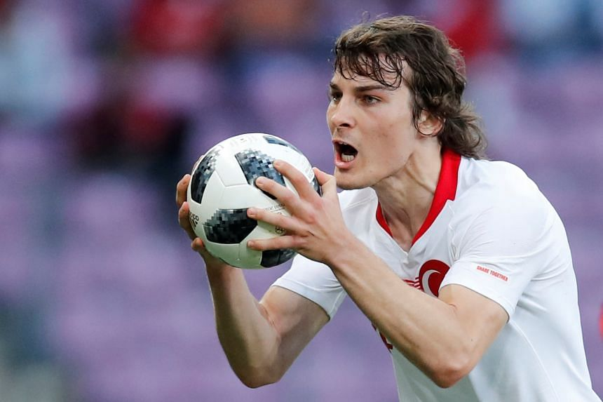 Turkey's Caglar Soyuncu reacts after being booked during the 2018 World Cup.