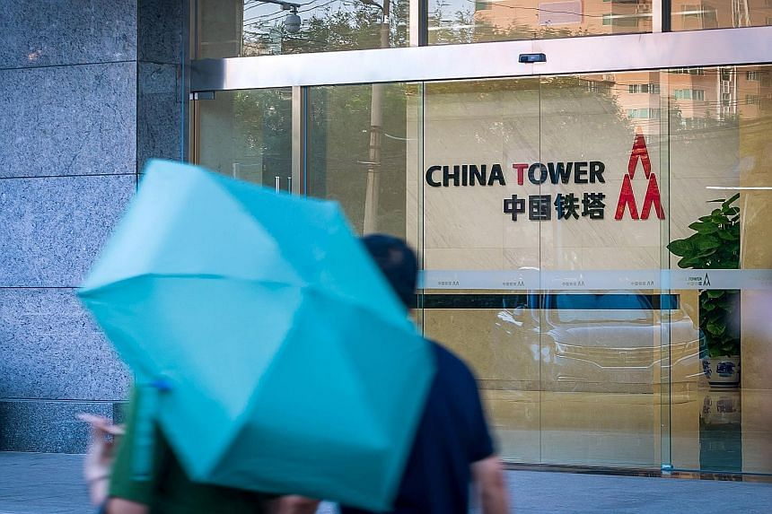 Mobile telecommunications tower operator China Tower (left) closed unchanged on its debut on Wednesday after completing the world's biggest initial public offering in two years. Its performance mirrors that of smartphone maker Xiaomi (right), another