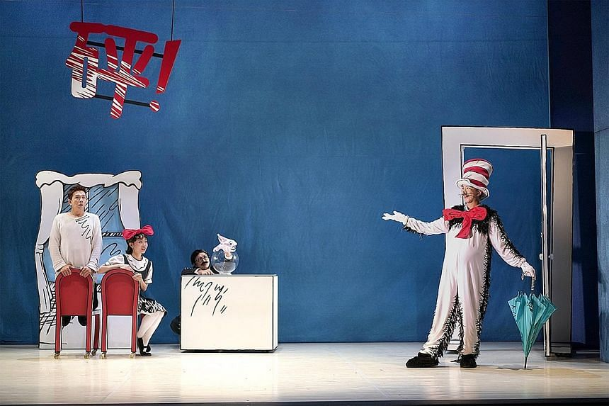 Hang Qian Chou (right) is the titular Cat In The Hat who has come to shake up the day of two children, played by (from left) Sugie Phua and Ann Lek.