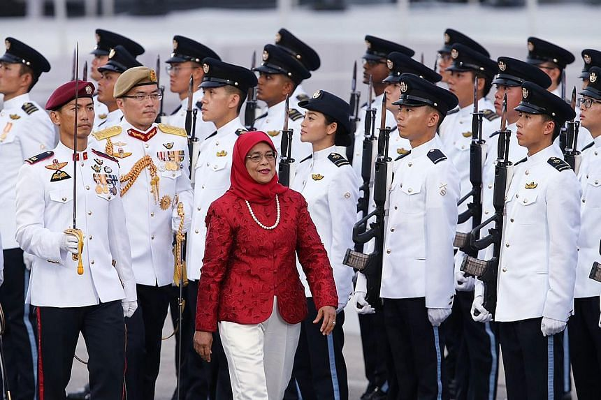 President Halimah Yacob inspecting the Guard of Honour yesterday. It was her first NDP as President, but not the first time she had a formal NDP role. Before she became President, she was the reviewing officer at every parade preview since 2013 when