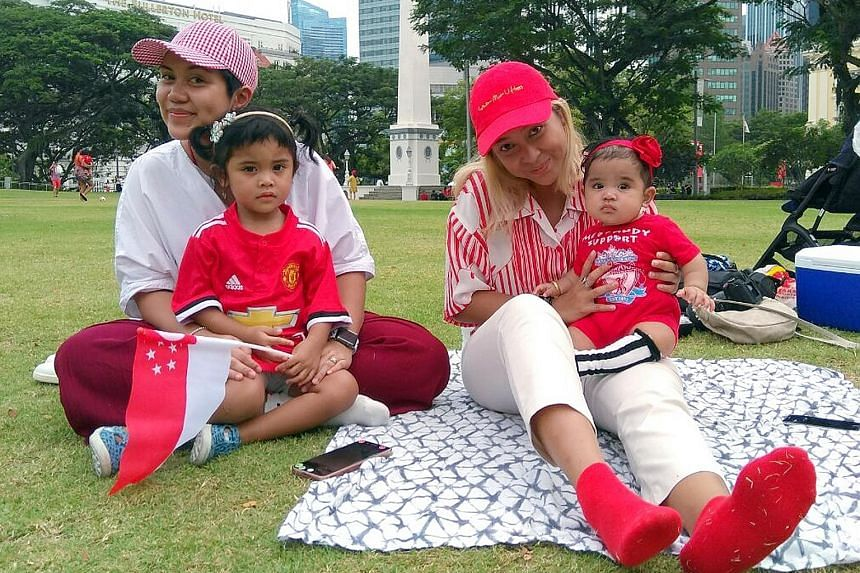 MS SHAZANA LATIFF (in white), 34, a finance administration manager who was with her daughters - Laiqa, three, and Lana, six months old - and cousin Waui Hamid, 30, a designer.