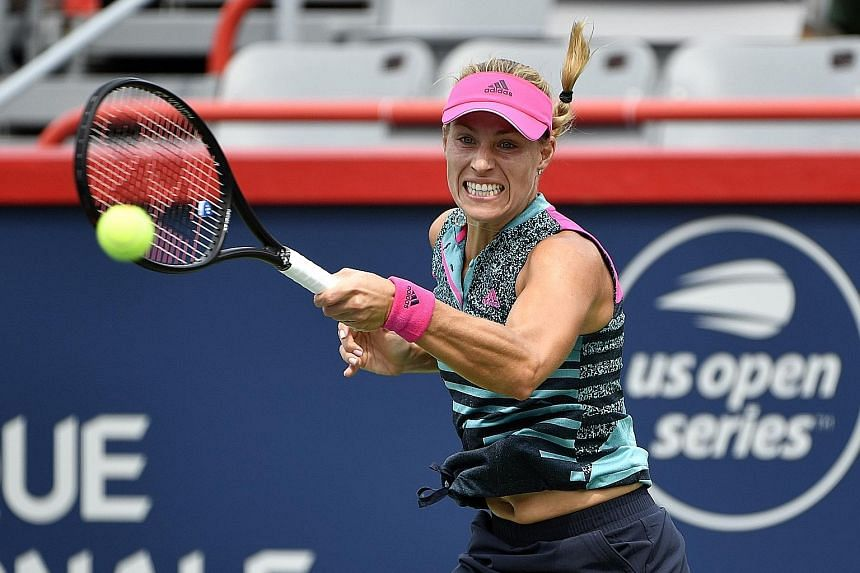 Germany's Angelique Kerber suffers on the hard court in her first match since her Wimbledon triumph, losing 6-4, 6-1 to France's Alize Cornet in the second round of the Rogers Cup.