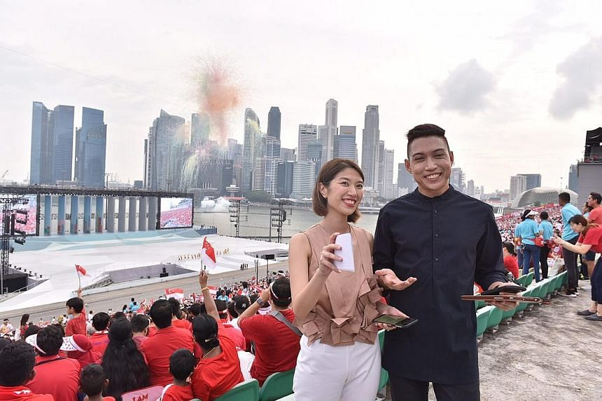Multimedia journalists Alyssa Woo and Hairianto Diman, who anchored the Hangout with ST show, at the Marina Bay Floating Platform.