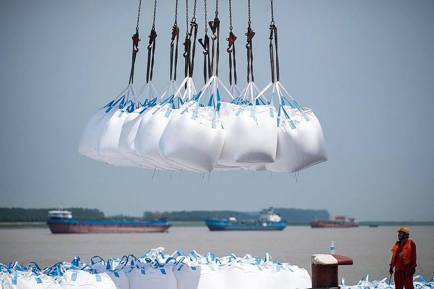 Bags of chemicals being unloaded at a port in Zhangjiagang, in China's Jiangsu province.