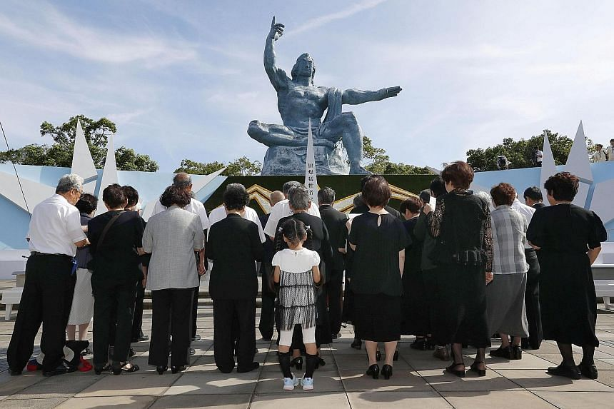Prayers were held for victims of the 1945 atomic bombing of the Japanese port city of Nagasaki on the 73rd anniversary yesterday. Crowds gathered to pay their respects in front of the 10m-tall Peace Statue at Nagasaki's Peace Park in western Japan. T