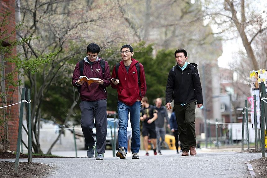 The writer argues that Asian American applicants to elite US universities are at a disadvantage due to the schools' preference for applicants who are outgoing, gregarious and comfortable in the spotlight, as evidence shows that Asians are less likely