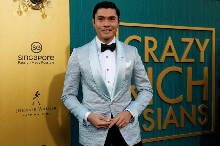 In photos that have now circulated around the world, it is evident that there are at least two errors printed on the board situated just behind where stars like Henry Golding (above) stop to pose for pictures.