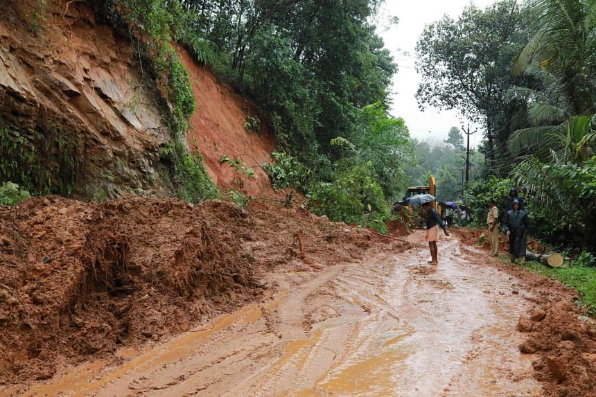 Indian rescuers conduct rescue operations after a landslide at Kuttampuzha village in Ernakulam district in Kerala, India, on Aug 9, 2018.