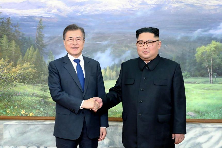 File photo of South Korean President Moon Jae-in shaking hands with North Korean leader Kim Jong Un during their summit at the truce village of Panmunjom, North Korea, on May 26, 2018.