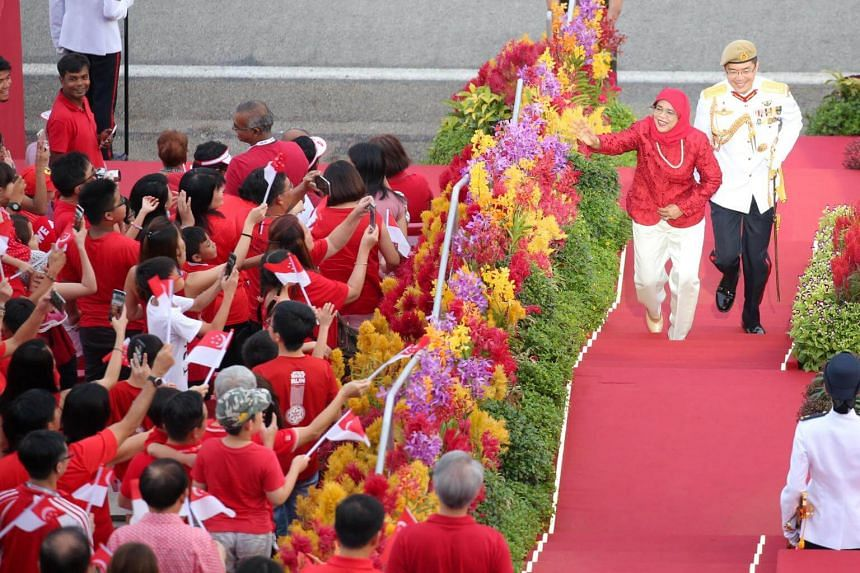 President Halimah Yacob arriving at her first National Day Parade as the President, on Aug 9, 2018.