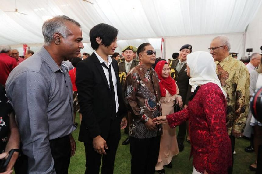 Mr Mashruddin Saharuddin (third from left) and his son Nizaruddin (second from left) were among some 1,300 guests at the National Day reception hosted by President Halimah Yacob at the Istana on Aug 10, 2018.