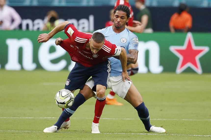 Bayern Munich's Franck Ribery (left) fighting for the ball with Luiz during an International Champions Cup friendly.
