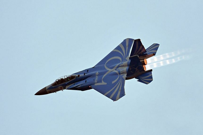 A Republic of Singapore Air Force F-15 jet taking part in the NDP aerial performance. It has been painted blue as part of the air force's 50th anniversary celebrations, slated for later this year.