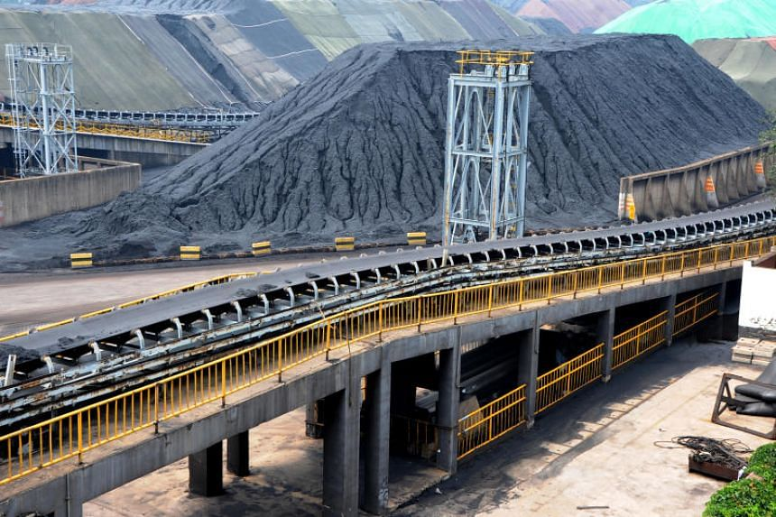 Piles of imported coal are seen at a coal terminal of a port in Lianyungang, Jiangsu province, China, on July 26, 2018.