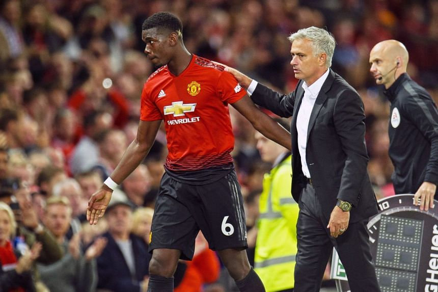 Mourinho reacts as Pogba leaves the pitch during the match.
