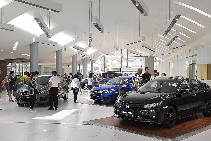 Car showrooms were packed with potential buyers after COE prices dipped in late June. However, if motor vehicle sales were excluded, retail takings in June would have just inched up a marginal 0.2 per cent.