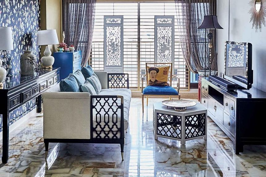 (Far left) Furniture with Oriental details, such as lacquer finishes, adorns the five-room flat. (Left) A freestanding claw-foot tub and handprinted floral mural create an old-world vibe in the bathroom. While the home owners have retained the marble