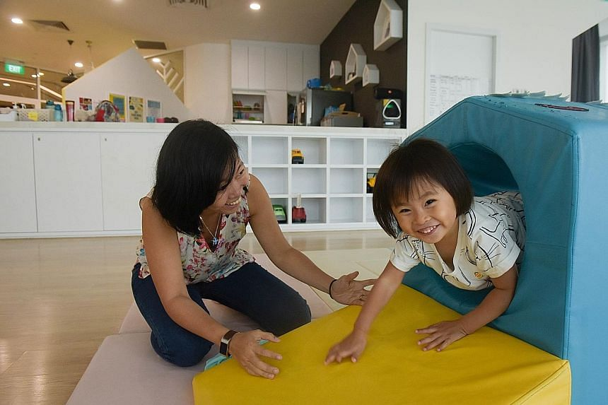 (Above) Three-year-old Terese Pereira playing with her mother, photographer Alexandria Neoh, in the co-working space at Trehaus. Trehaus sets itself apart by offering a family-friendly co-working space where the adults can do their work in one room (